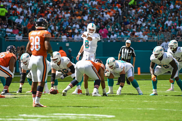 Miami Dolphins quarterback Brock Osweiler (8) points out a defender