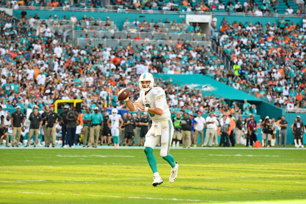 Miami Dolphins quarterback Brock Osweiler (8) looks for an open man in the endzone