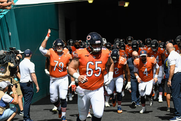 Chicago Bears center Cody Whitehair (65) leads the team onto the field