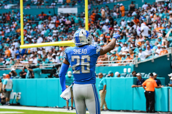 Detroit Lions defensive back DeShawn Shead (26) points to the crowd after the initial kickoff