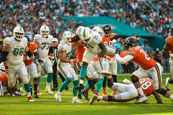 Miami Dolphins running back Frank Gore (21) hurdles a defender