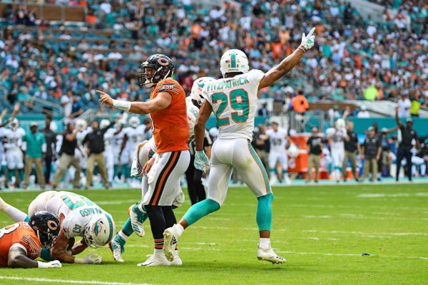 Miami Dolphins free safety Minkah Fitzpatrick (29) signals Miami recovered the fumble