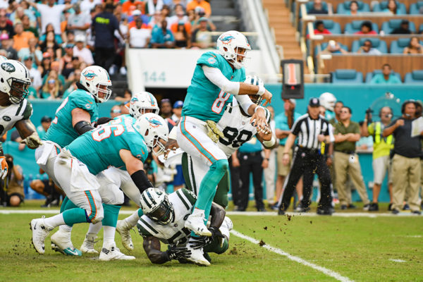 Miami Dolphins quarterback Brock Osweiler (8) throws under pressure