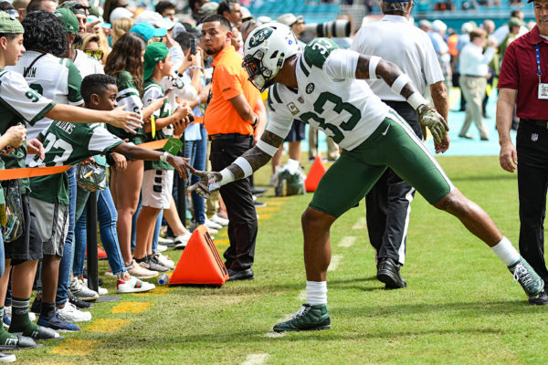 New York Jets strong safety Jamal Adams (33) reaches out to a fan during drills