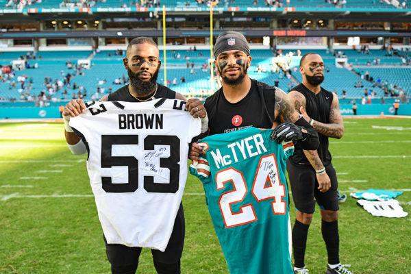 Jacksonville Jaguars linebacker Blair Brown (53) and Miami Dolphins cornerback Torry McTyer (24)