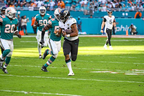 Jacksonville Jaguars running back Carlos Hyde (34) breaks free