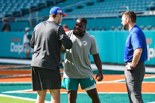 Buffalo Bills quarterback Josh Allen (17) and Miami Dolphins running back Frank Gore (21) meet during warmups