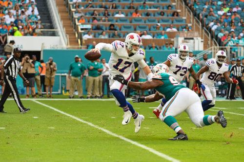 Buffalo Bills quarterback Josh Allen (17) evades a tackler