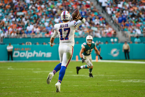 Buffalo Bills quarterback Josh Allen (17) throws on the run