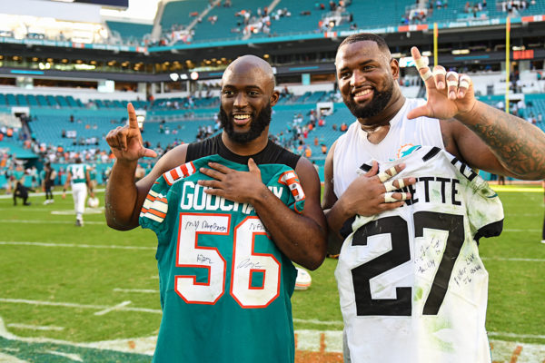 Miami Dolphins defensive tackle Davon Godchaux (56) and Jacksonville Jaguars running back Leonard Fournette (27)