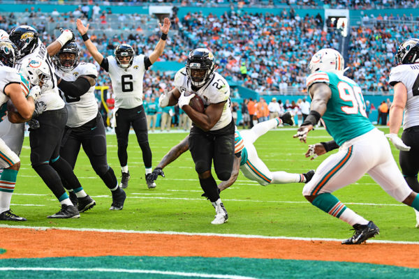 Jacksonville Jaguars quarterback Cody Kessler (6) signals touchdown as Jacksonville Jaguars running back Leonard Fournette (27) rushes in for the score