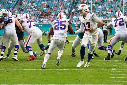 Buffalo Bills quarterback Josh Allen (17) hands off to Buffalo Bills running back LeSean McCoy (25)