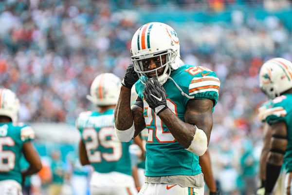 Miami Dolphins free safety Reshad Jones (20) adjusts his helmet