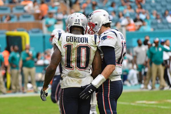 New England Patriots quarterback Tom Brady (12) and New England Patriots wide receiver Josh Gordon (10)