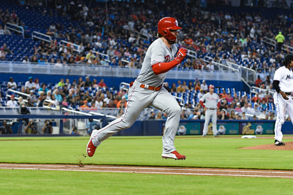 Philadelphia Phillies right fielder Bryce Harper (3) tries to beat the throw to first