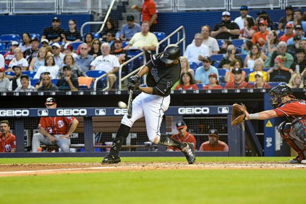 Miami Marlins left fielder Curtis Granderson #21 hits a home run