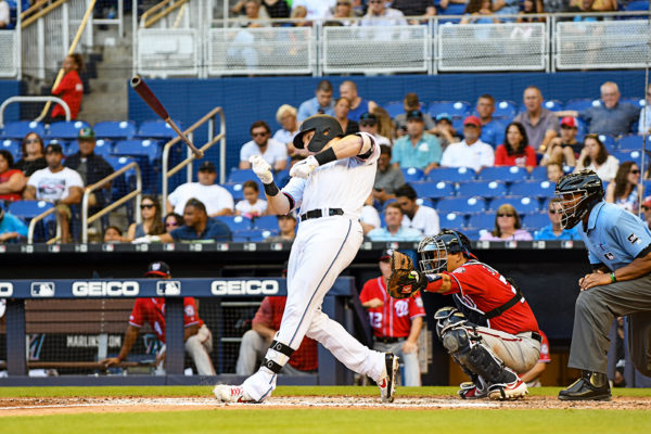 Miami Marlins catcher Chad Wallach #17 loses the grip on his bat