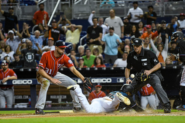 Miami Marlins right fielder Isaac Galloway #79 slides safely into home