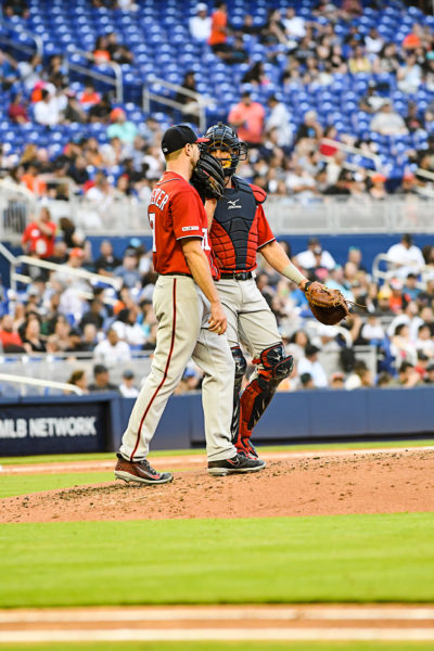 Washington Nationals starting pitcher Max Scherzer #31 talks with Washington Nationals catcher Yan Gomes #10 on the mound