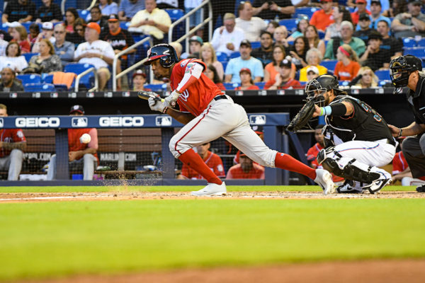 Washington Nationals center fielder Victor Robles #16 lays down a bunt