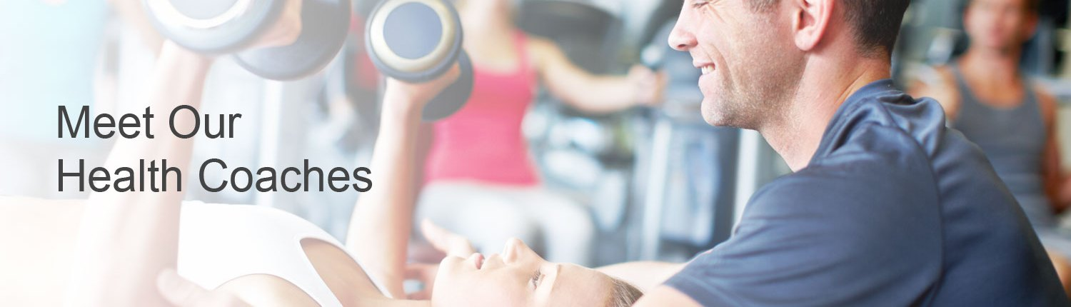 Health coach helping young woman bench press
