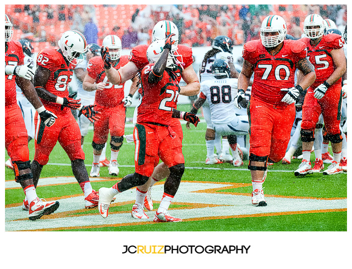 #25, Hurricanes RB Dallas Crawford, celebrates his touchdown with teammates
