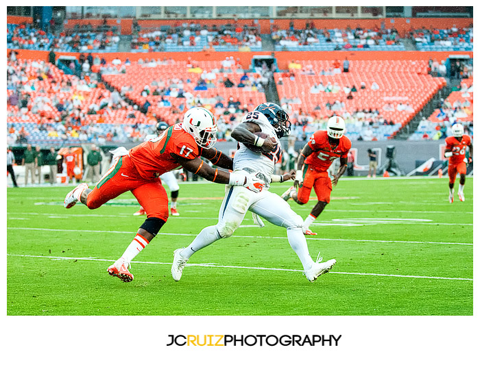 Virginia RB, #25 Kevin Parks, eludes the tackle of Hurricanes lineman, #17 Tyriq McCord