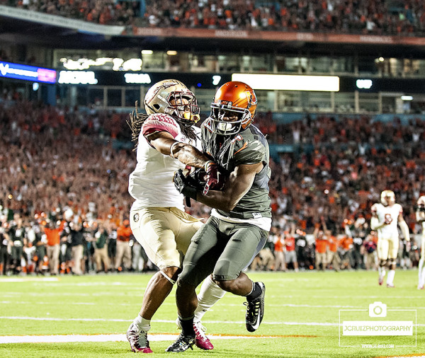 Miami WR #4 Phillip Dorsett scores a touchdown as Florida State DB #3, Ronald Darby, tries to take the ball away