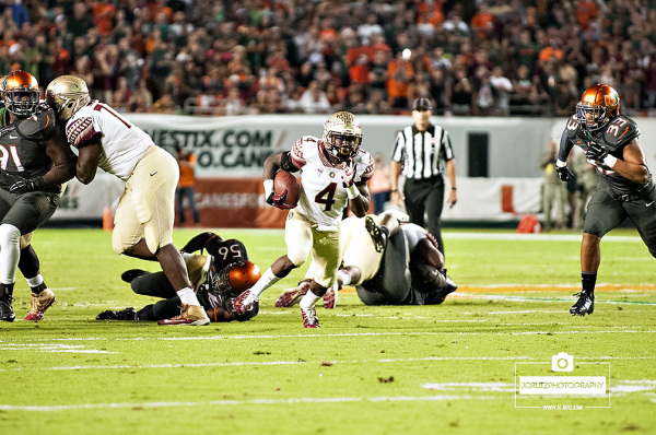Florida State Seminoles RB #4, Dalvin Cook, finds a hole against the Miami Hurricanes defense