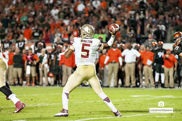 Florida State QB #5 Jameis Winston attempts a pass