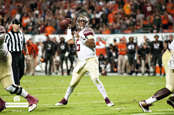 Florida State QB #5 Jameis Winston attempts a pass against the Miami hurricanes