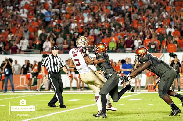 Miami Hurricanes DB #2, Deon Bush, greets Florida State QB #5 Jameis Winston