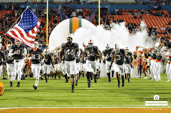 The Miami Hurricanes run out of the tunnel on Senior Day