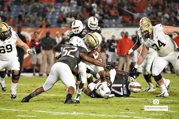 Denzel Perryman makes a tackle