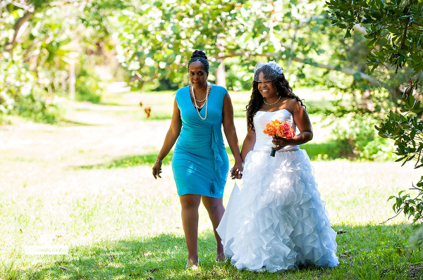 the brides mother walking her down the aisle