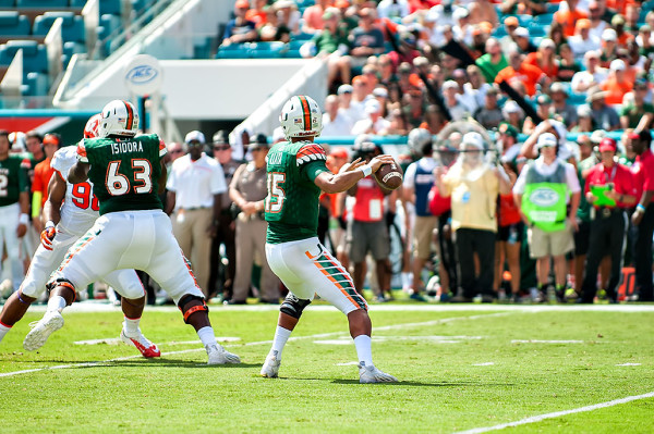 Miami Hurricanes QB #15, throws a pass against Clemson