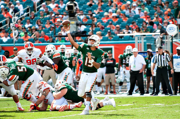 Miami Hurricanes QB #15, Brad Kaaya, attempts a pass against the Clemson Tigers