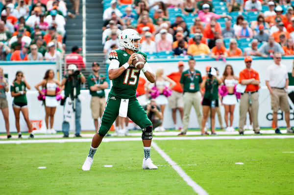 Miami Hurricanes QB #15, Brad Kaaya, looks to throw a pass