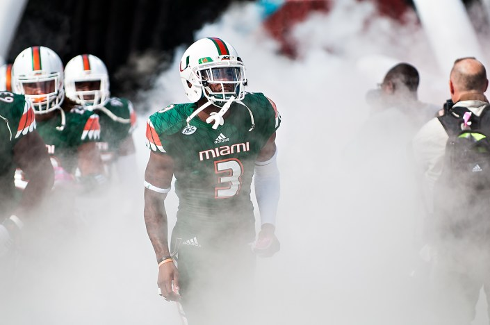 Miami Hurricanes WR #3, Stacy Coley, runs through the smoke