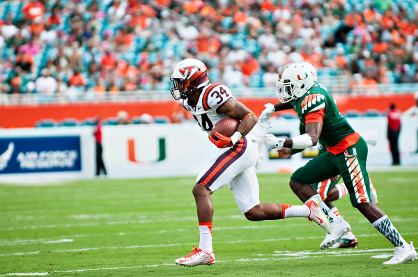Virginia Tech RB #34, Travon McMillian, tries to elude the Miami Hurricanes defense