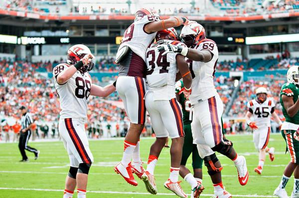 Virginia Tech players celebrate a touchdown by RB #34, Travon McMillian