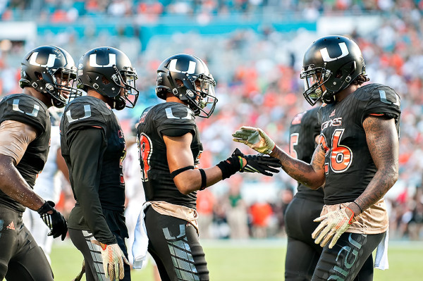Hurricanes CB, Corn Elder, celebrates with teammates after a defensive stop