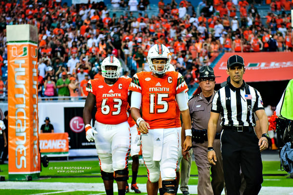 The game day captains walk out to midfield