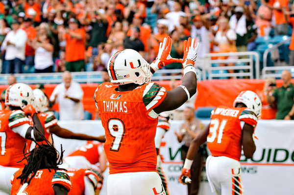 """Chad Thomas throws up the """"U"""" prior to the game"""