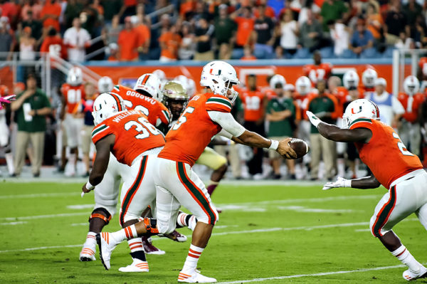 Miami QB, Brad Kaaya, hands off to Joe Yearby