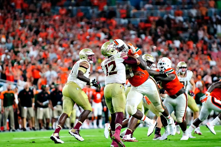Hurricanes DL, Chad Thomas, gets up close and personal with Florida State QB, Deondre Francois