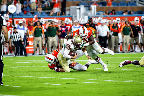 Hurricane defenders, Joe Jackson and Gerald Willis, sack Florida State QB, Sean Maguire