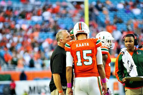 Hurricanes head coach, Mark Richt, talks to Brad Kaaya during a timeout