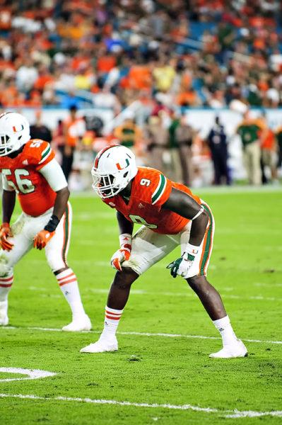 Chad Thomas lines up on defense