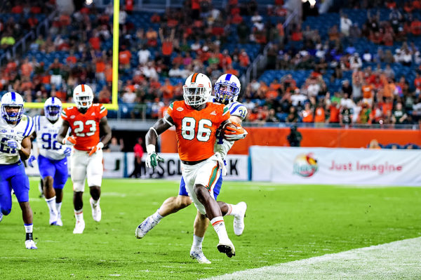 Hurricanes TE, David Njoku, runs up the sideline for a touchdown